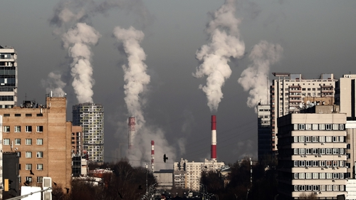 Smoke rises from the chimneys of a gas boiler house in Moscow