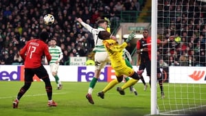 Celtic's Ryan Christie and Rennes goalkeeper Edouard Mendy battle for the ball