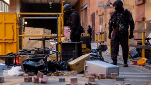 Officers from a bomb disposal unit search the campus of Hong Kong Polytechnic University