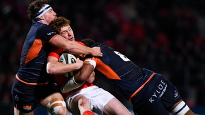 Ben Healy of Munster is tackled by Hamish Watson and Villame Mata