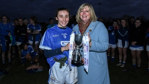 Marie Hickey, LGFA President, presents the Mick Talbot Cup to Munster captain Melissa Duggan
