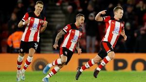 James Ward-Prowse (R) wheels away in celebration after scoring the winner