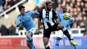 John Stones in action against Newcastle United's Joelinton