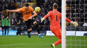 Matt Doherty heads home the equaliser for Wolves