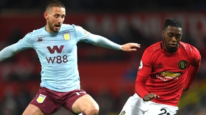 Conor Hourihane of Aston Villa battles for possession with Aaron Wan-Bissaka