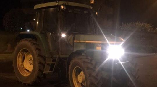 Young boys driving tractor stopped in Trim
