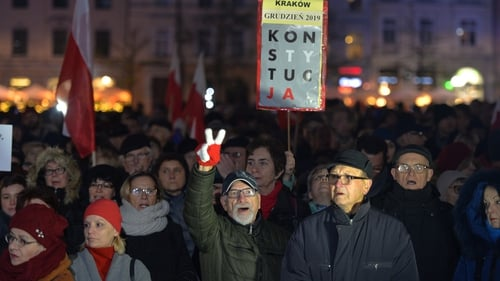 """Demonstrators in the capital carried EU flags and signs saying """"honour and glory to unbreakable judges"""""""