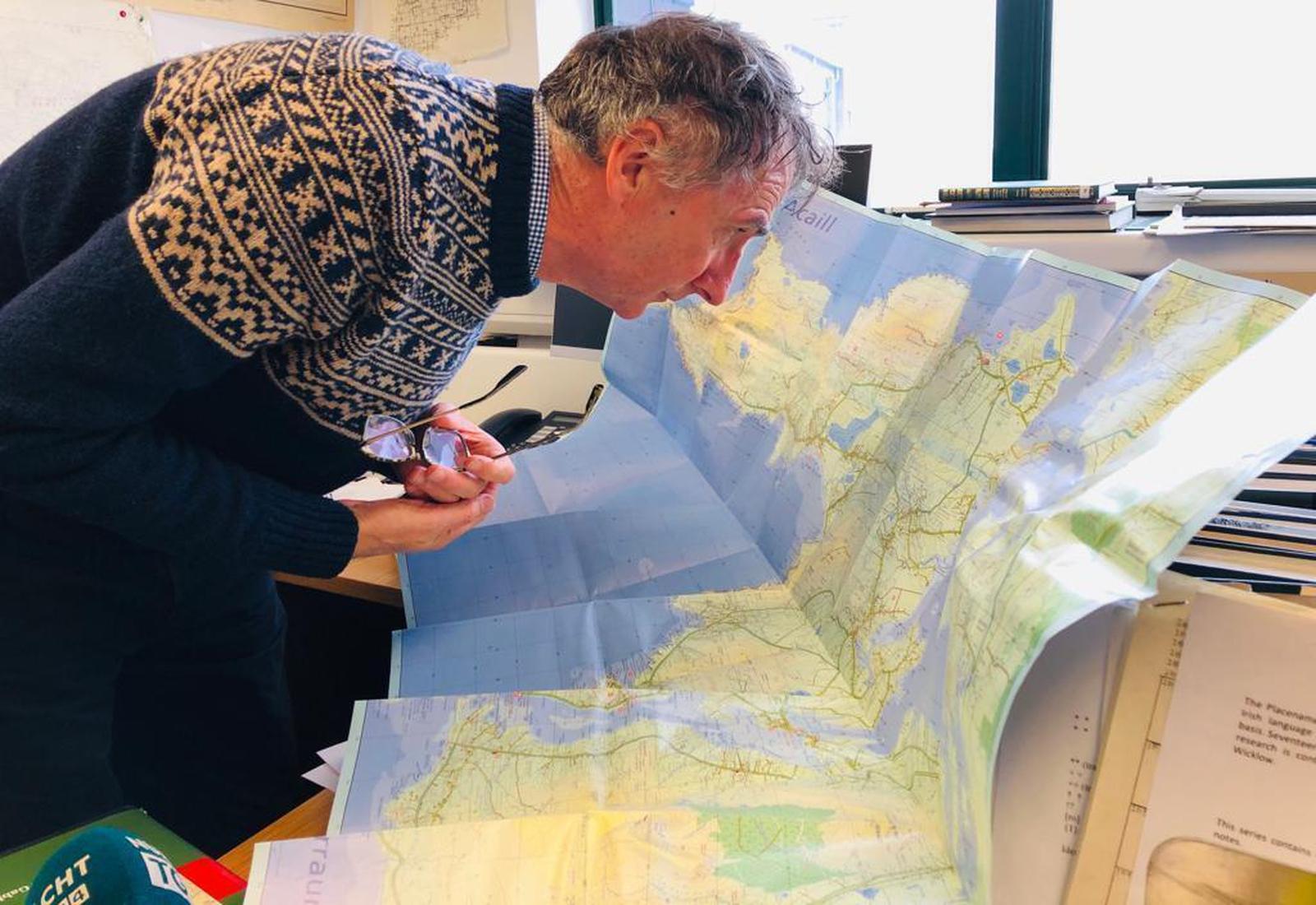 Image - Pádraig Ó Cearbhaill examining the map