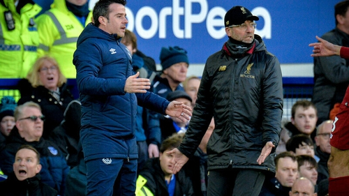 Everton boss Marco Silva (L) and Liverpool head coach Jurgen Klopp have experienced very different fortunes this season