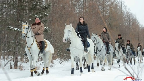 Kim Jong Un was pictured leading a squad of riders in a white forest near Mount Paektu
