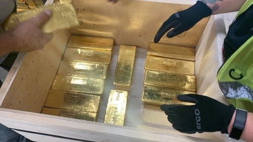 The 12.5kg gold bars were placed in wooden crates and loaded into security trucks (Pic: G4S)
