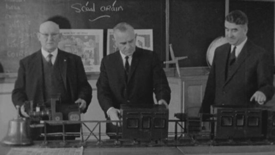 Michael Ash, Michael Caine and Bryan MacMahon with model of the Lartigue monorail, Listowel (1964)