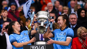 Siobhán Woods, left, and Lucy Collins of Dublin lift the Brendan Martin Cup