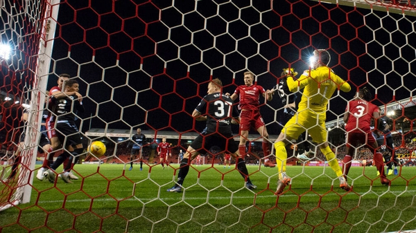 Aberdeen's Sam Cosgrove heads a chance wide during the Premiership match against Rangers at Pittodrie