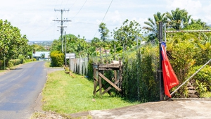A red flag hanging outside a home in Samoa indicating the residents have not been vaccinated for measles