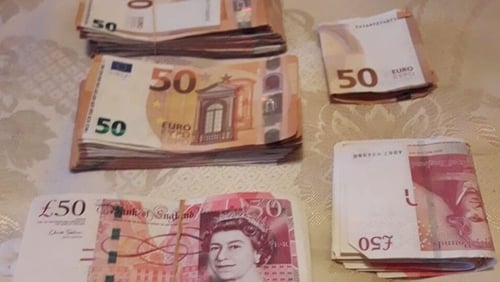 £12,000 and €10,000 in cash were seized during the searches
