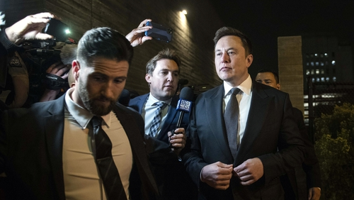 Tesla chief executive Elon Musk (R) tweeted the comment in June 2018