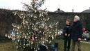 Catherine Corless and survivor Peter Mulryan at the Christmas tree in Tuam