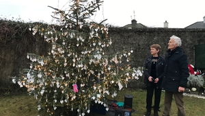 Catherine Corless and survivor Peter Mulryan at the Christmas tree in Tuam