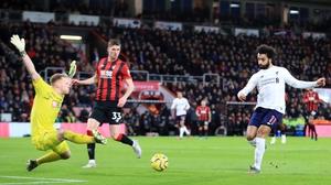 Mohamed Salah (R) scores Liverpool's third goal