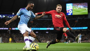 Raheem Sterling comes under pressure from Luke Shaw in the Manchester derby