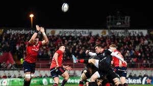 Saracens scrum-half Ben Spencer clears his lines against Munster