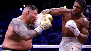 Anthony Joshua connects with a meaty right cross in his win over Andy Ruiz Jr