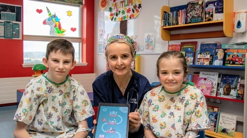 Dr Anne Dolan with Hugh Gannon from Sandyhill and Ellie Langan from Grange