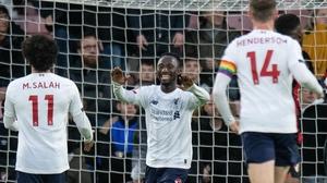Naby Keita celebrates with his team-mates
