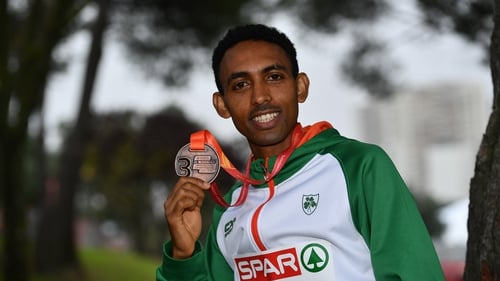 Gidey poses with his bronze medal in Lisbon