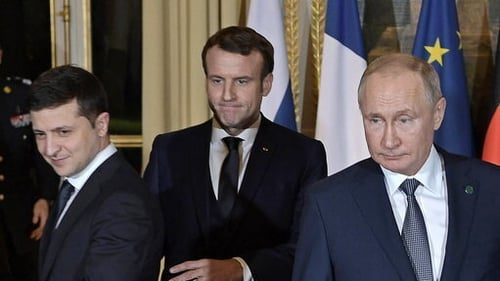 French President Emmanuel Macron (C) hosted the first face-to-face meeting between the Ukrainian and Russian presidents