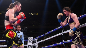 Katie Taylor (R) and Delfine Persoon during their fight at Madison Square Garden