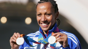 Kelly Holmes shows off her two gold medals back in 2004