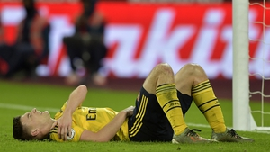 Kieran Tierney winces in pain at the London Stadium