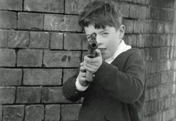 Boy playing with a toy gun on Bombay Street  (1970)