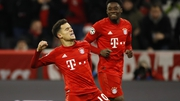 Philippe Coutinho celebrates scoring his side's third goal at the Allianz Arena