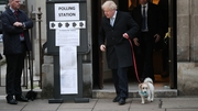Prime Minister Boris Johnson with his dog, Dilyn, after casting his vote at Methodist Central Hall, London