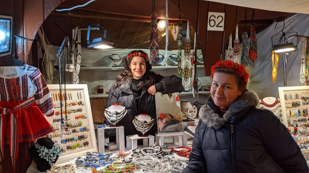 Anastazja (left) and her mother, selling handmade Polish wares from their stall, Galina Kavowska, at Krakow Christmas Market (Jonjo Maudsley/PA)