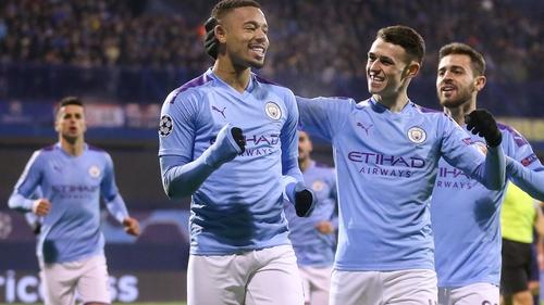 Gabriel Jesus (C) celebrates scoring with team-mate Phil Foden