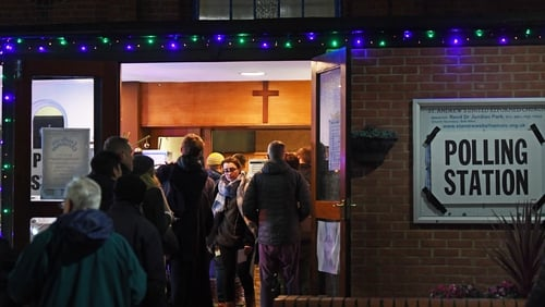 Voters queue outside St Andrews Church polling station in Balham, south London, this evening