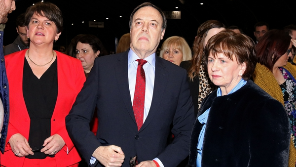 Nigel Dodds, pictured alongside his wife Diane and DUP leader Arlene Foster, had held the seat for 18 years