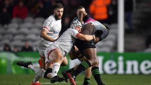 Vereniki Goneva of Harlequins is tackled by Luke Marshall of Ulster