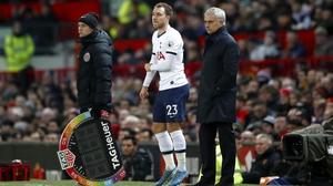 Tottenham Hotspur's Christian Eriksen (C) on the touchline with  manager Jose Mourinho (R)