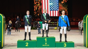 Darragh Kenny stands second on the podium in Geneva
