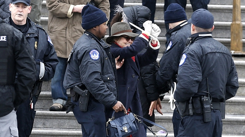 Sally Field being escorted away by police