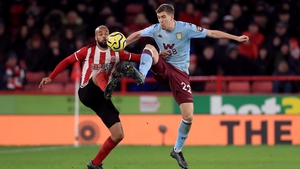 Aston Villa's Bjorn Engels (right) and Sheffield United's David McGoldrick
