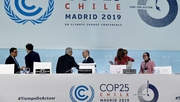 Delegates leave after the closing plenary session of the UN Climate Change Conference in Madrid