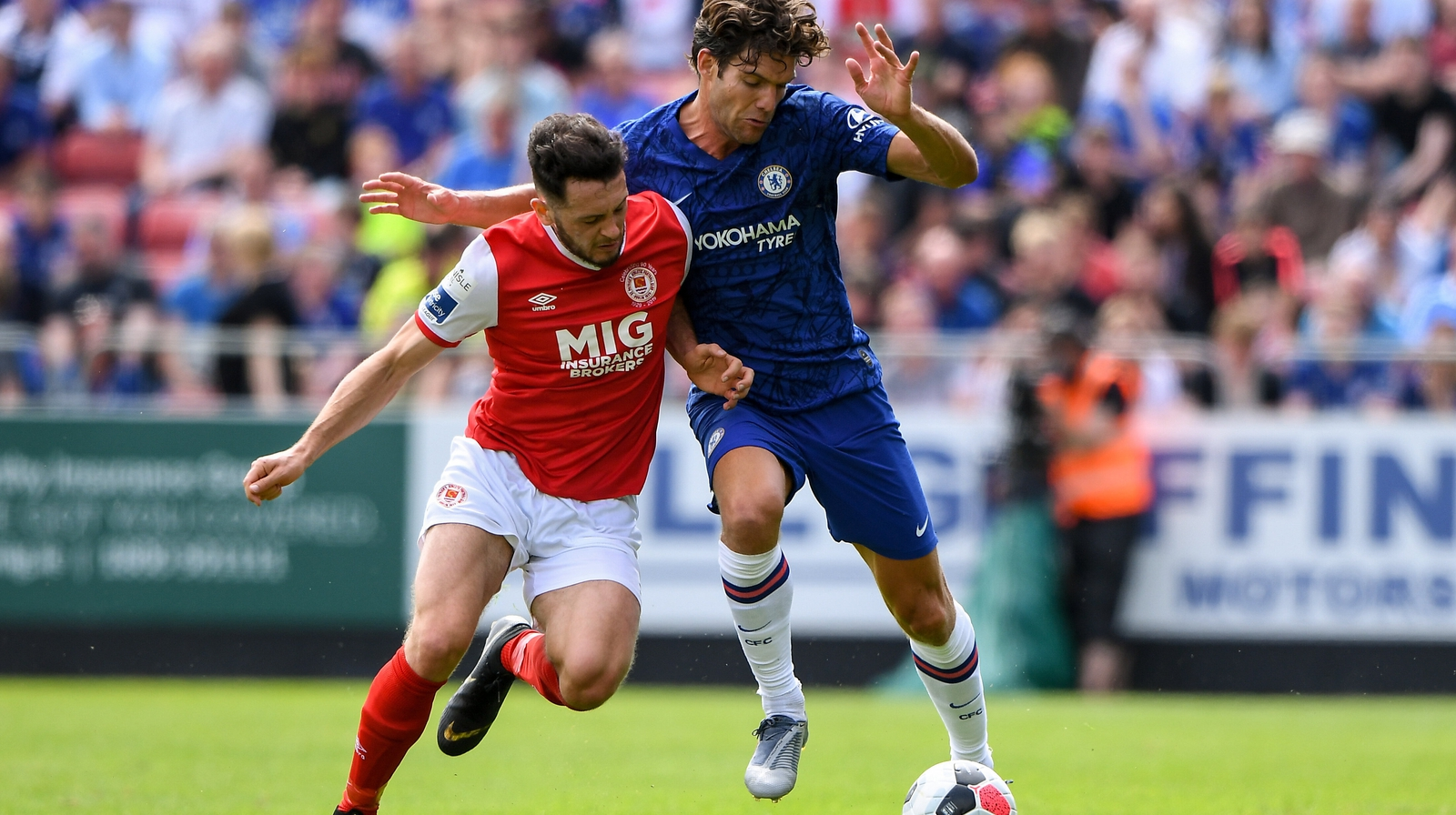Image - Eric Molloy fends off Chelsea's Marcos Alonso during pre-season this year