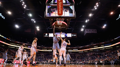 Memphis Grizzlies' Jaren Jackson Jr. (13) attempts a shot over Dario Saric (20) of the Phoenix Suns