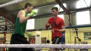 Stevie and Aaron McKenna going through their training routine in the family gym in Smithborough